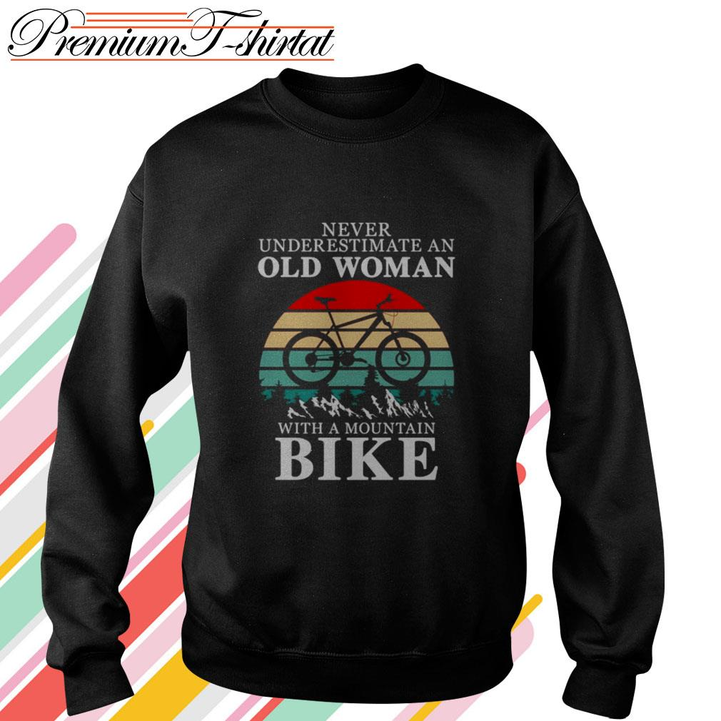 Never underestimate an old woman with a mountain bike vintage Sweater